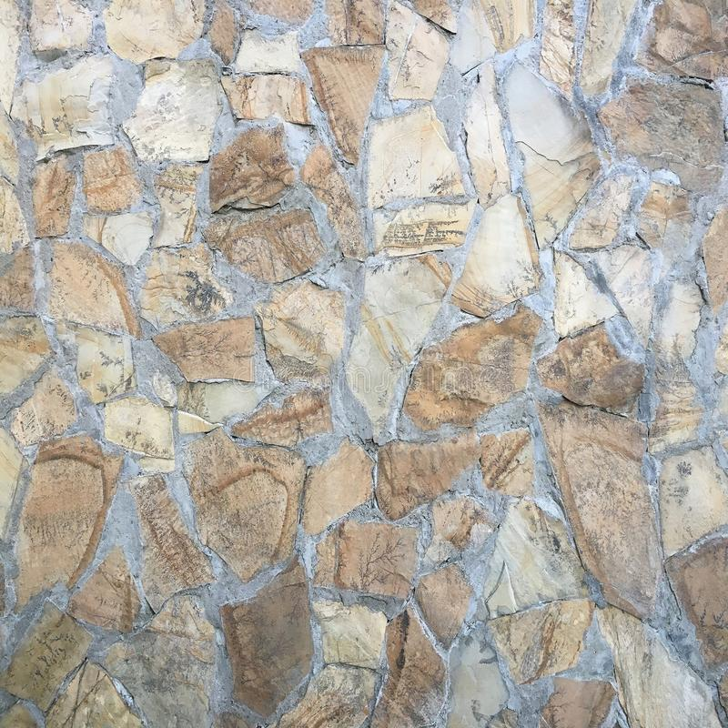 Stone block road pavement as texture. Background wall or floor with paving stones. Rock tile wallpaper. stock image