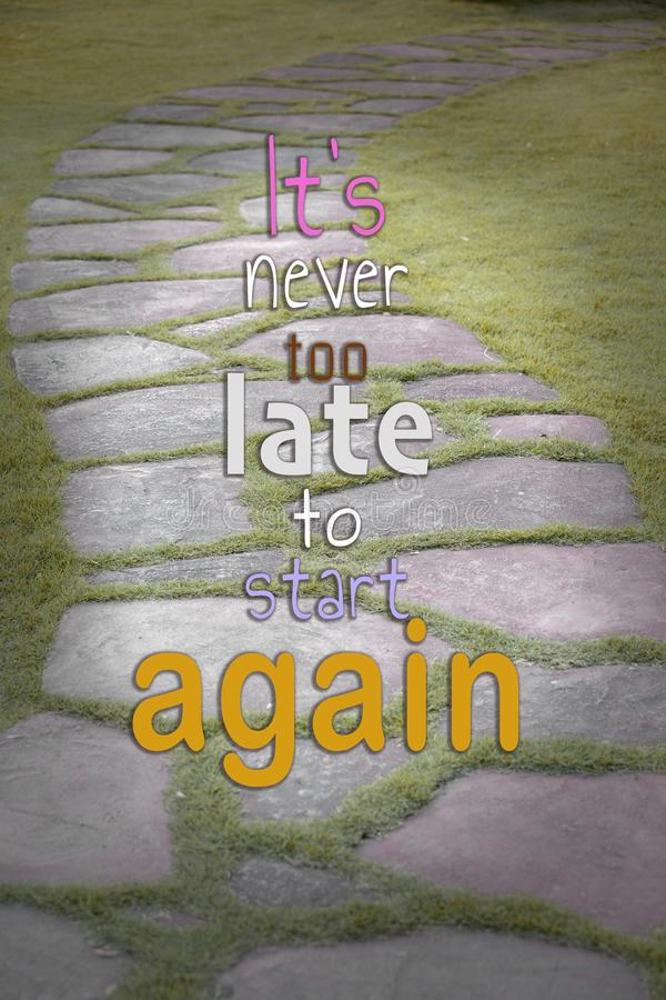 """The Stone block walk path in the park with  word """"It's never too late to start again.  stock photos"""