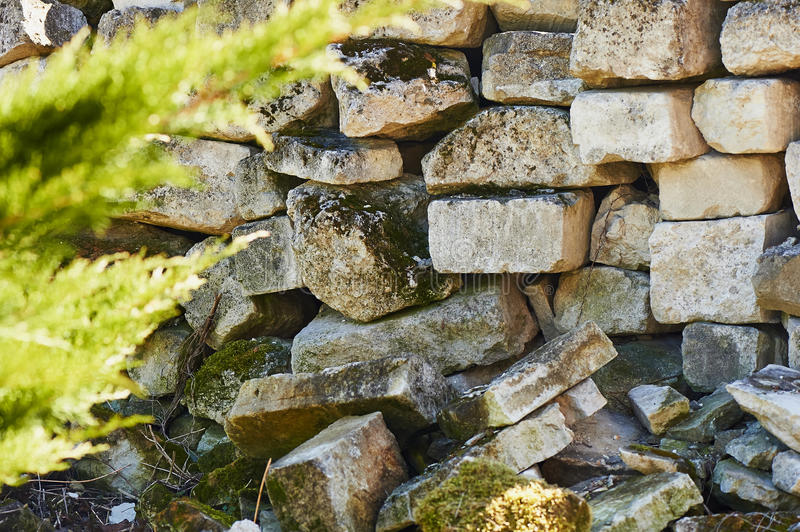 Stone blocks are grey in colour and pile. Background image stock photography