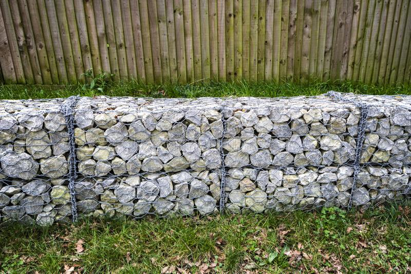 Caged stone block wall for construction projects. Stone blocks held in wire cages for use in building and construction industries - especially in countryside royalty free stock image