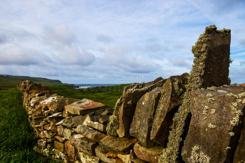 Stone boundary with lichen and moss stock photos