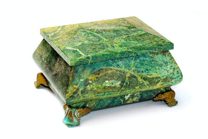 Stone box of malachite on a white background royalty free stock images