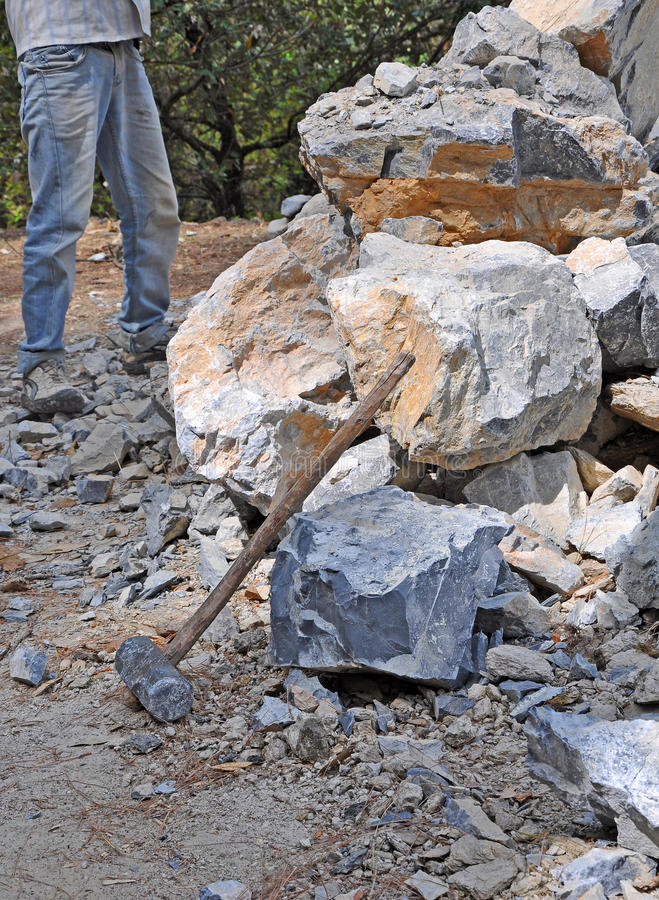 Stone breakers. Breaking stone with hammer into small pieces royalty free stock image