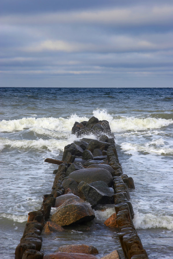 Stone Breakwater In Winter Stock Photo