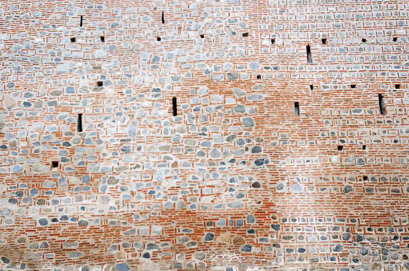 Download Stone And Brick Monastery Wall With Crenels Within Stock Image - Image: 28218743