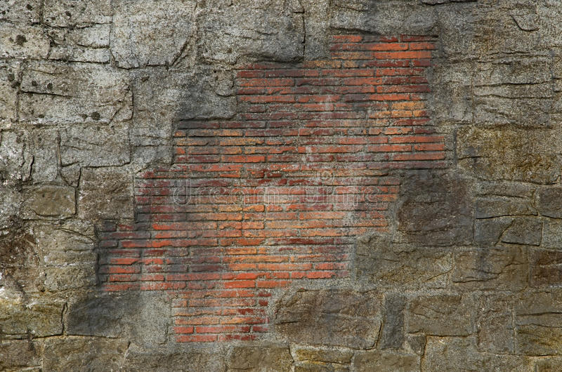 Stone and brick wall. Stone wall with part from brick. Texture useful for background royalty free stock image