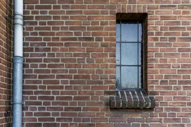 Stone brick wall pattern with a old dirty glass window framework in stained glass retro architecture background royalty free stock photos