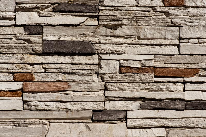 Stone Brick wall seamless background - texture pattern for continuous replicate. royalty free stock photos