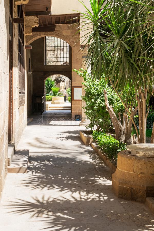 Stone bricks passage leading to the courtyard of historic Beit El Sehemy house, Cairo, Egypt. Cairo, Egypt- May 5 2015: Stone bricks passage leading to the stock photography