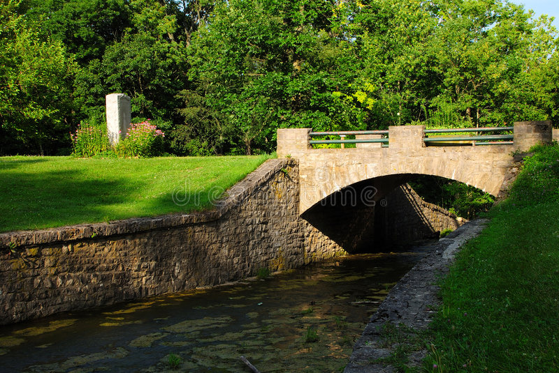 Stone Bridge. This is a stone bridge. It is located on a spill way for an old mill royalty free stock image