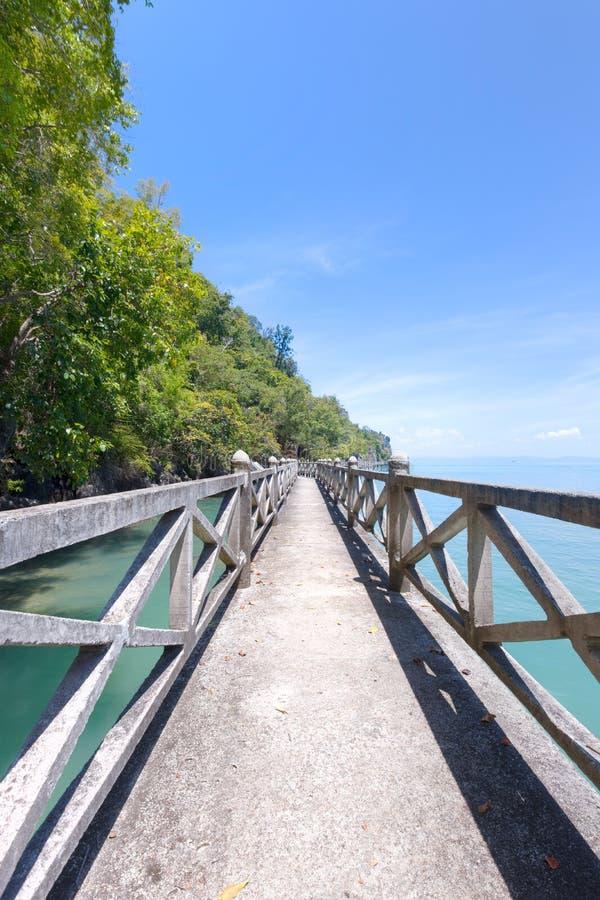 Stone bridge along coast line stock image