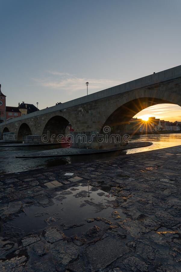 Free Stone Bridge And Skyline Of Regensburg With Setting Sun On Clear Winter Day Stock Photo - 178310640