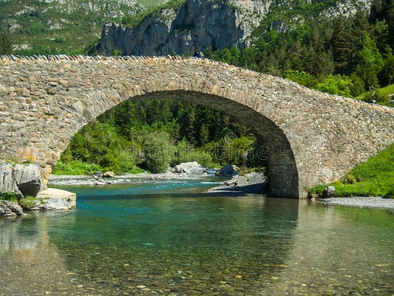 Stone bridge in the Aragonese Pyrenees stock photography