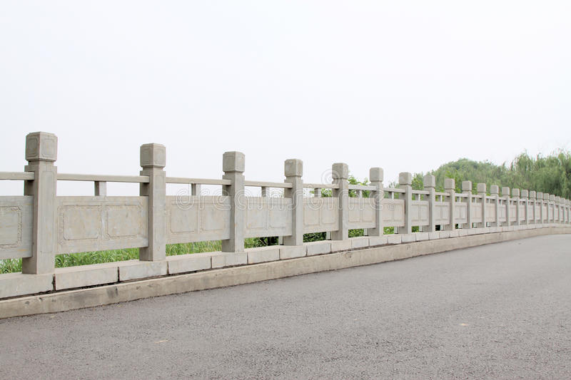Stone bridge baluster. In a park royalty free stock photo