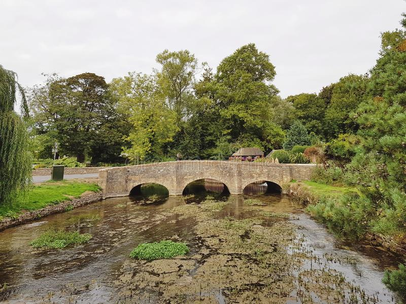 Stone bridge in Bibury, United Kingdom royalty free stock photography