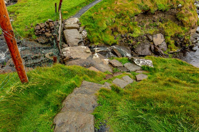 Stone bridge of the coastal route walk from Doolin to the Cliffs of Moher. Geosites and geopark, Wild Atlantic Way, spring rainy day in in the countryside in stock photos