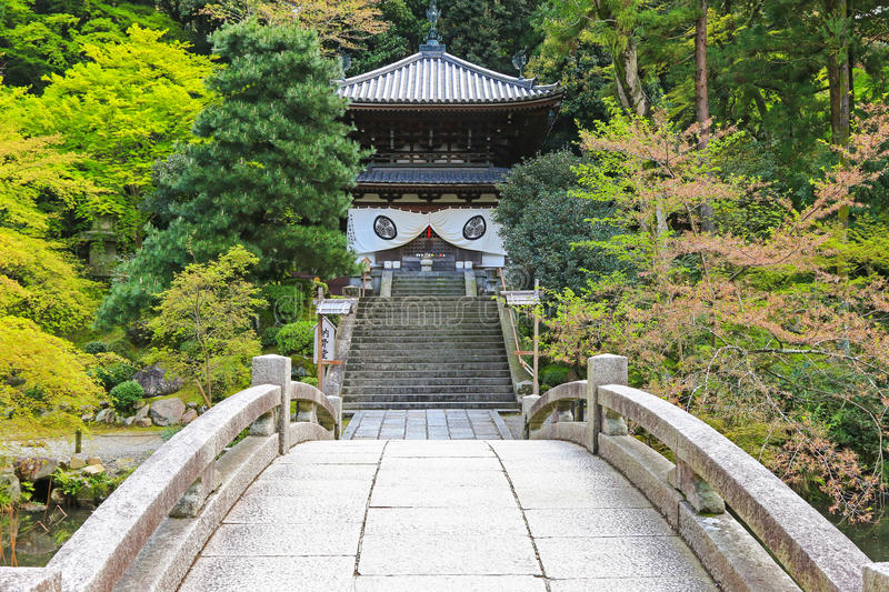 Stone bridge in the garden crossing to the Chionin Temple in Kyoto, Japan royalty free stock images