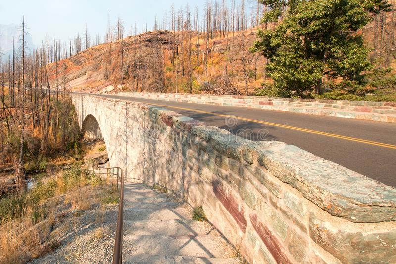 STONE BRIDGE OVER BARING CREEK ON THE GOING TO THE SUN ROAD IN GLACIER NATIONAL PARK IN MONTANA USA. STONE BRIDGE OVER BARING CREEK ON THE GOING TO THE SUN ROAD royalty free stock photography