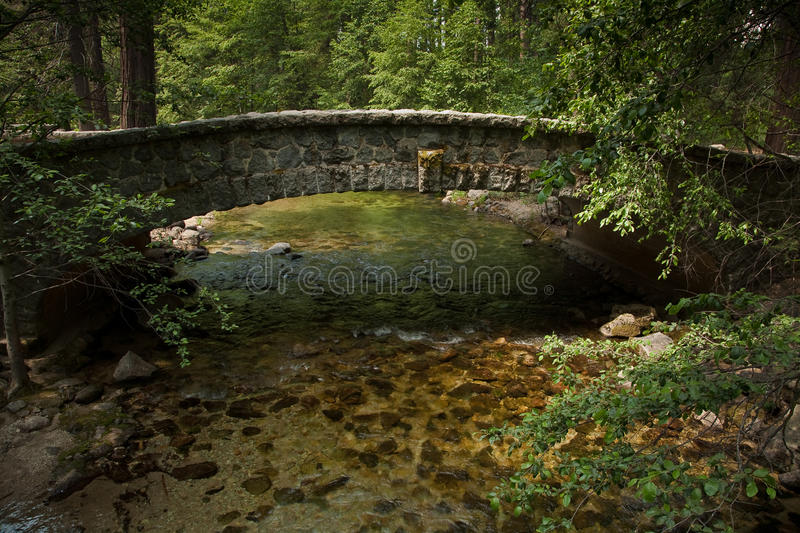 Stone bridge over a valley stream in Yosemite royalty free stock photo