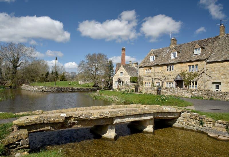 Stone bridge, River Eye, Lower Slaughter. Stone bridge over River Eye, Lower Slaughter, Gloucestershire royalty free stock image