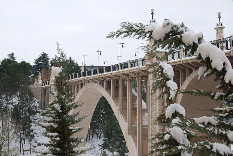 Stone bridge with snow in Teruel stock photography
