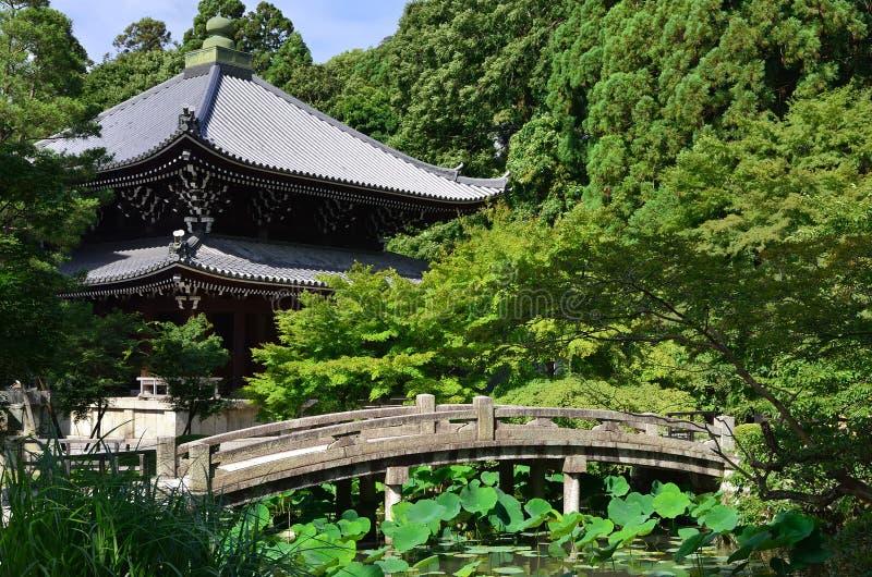 Stone bridge and temple, Japan stock photo