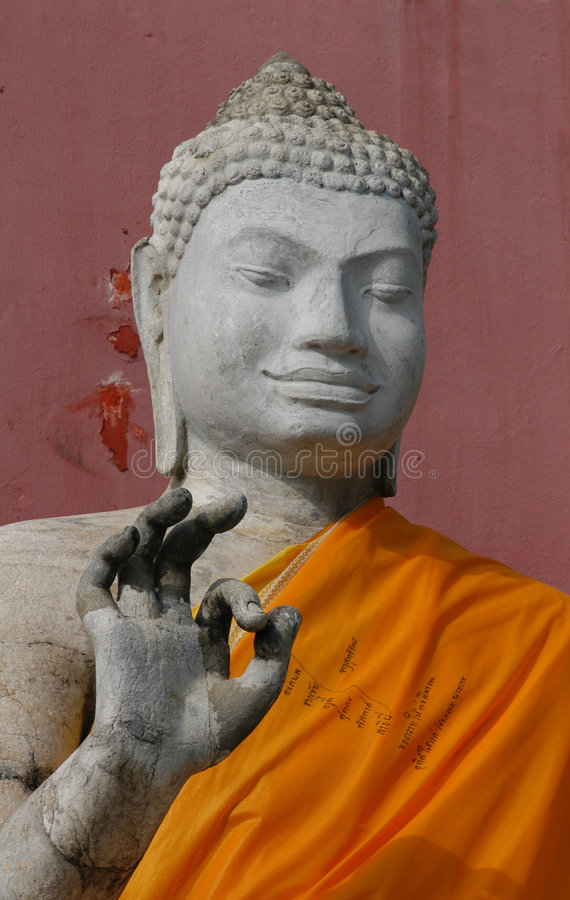 Stone Buddha. Making OK sign from the temple of Nakhon Pathom, Thailand stock images