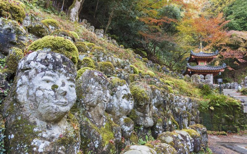 Stone buddha statue in kyoto, japan royalty free stock images