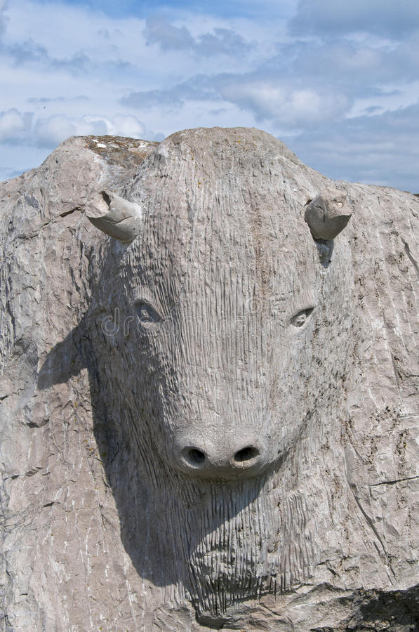Stone Bull. A carving of a powerful bull carved in Portland Stone from Dorset in England royalty free stock photo