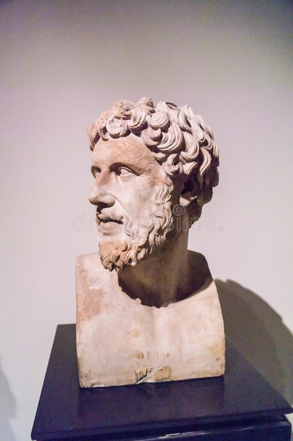 Bust of a Greek poet in the Archaeological Museum in Naples. Stone bust of a bearded Greek poet kept in the Archaeological Museum in Naples stock images
