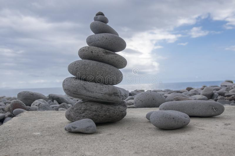 Stone cairn tower, poise stones, rock zen sculpture, light grey pebbles royalty free stock photography