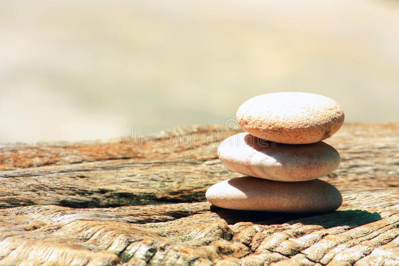 Download Stone Cairn On A Wood Royalty Free Stock Photo - Image: 14229375
