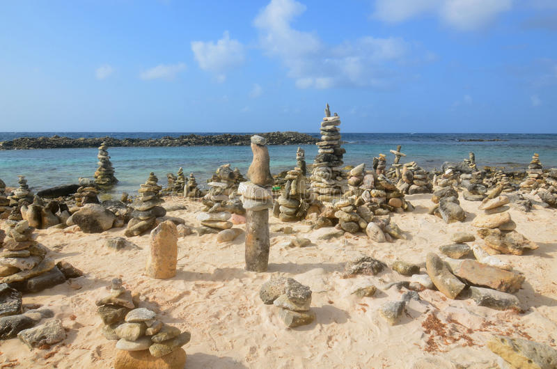 Stone Cairns on Baby Beach In Aruba. Stacked stone cairns on Baby Beach in Aruba royalty free stock image