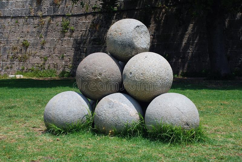 Stone cannonballs, Rhodes royalty free stock image