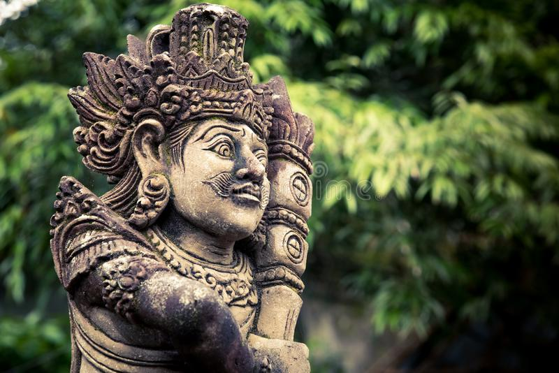 Stone carved balinese statue royalty free stock photos