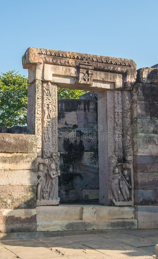 Stone Carved Entrance Gate of Historic Temple. At Sanchi Madhya Pradesh Central India showing various figures and floral design stock photos