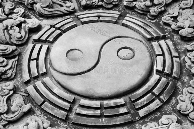 The stone carving of chinese yin yang symbol. royalty free stock image