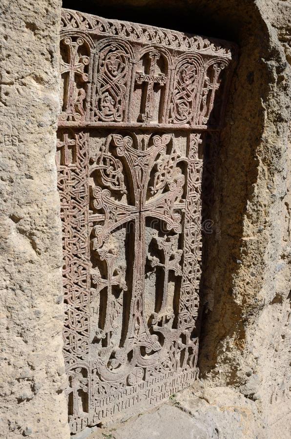 Stone carving - christian cross in Geghard monastery,Central Asia,Armenia,Caucasus, unesco heritage site royalty free stock image