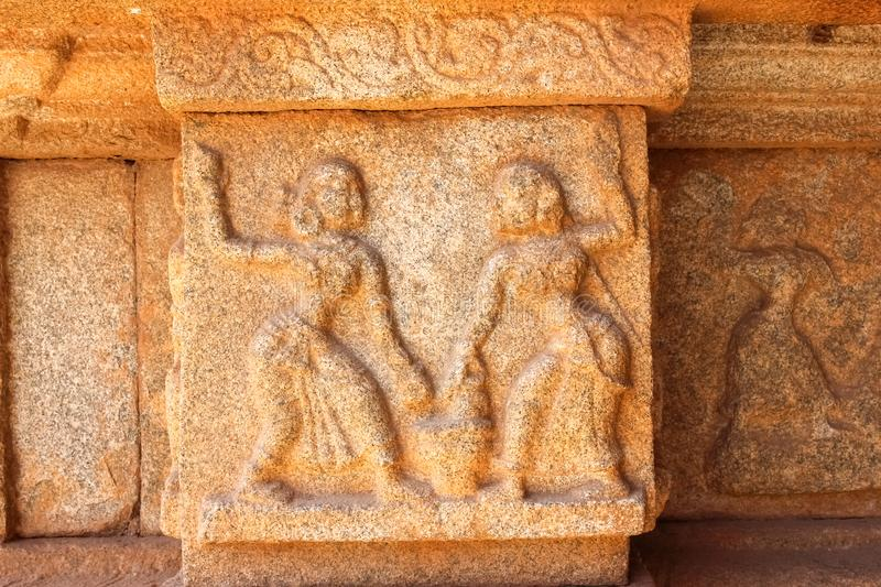 Stone carving of female dancing duo in the ancient ruins of hampi stock photos
