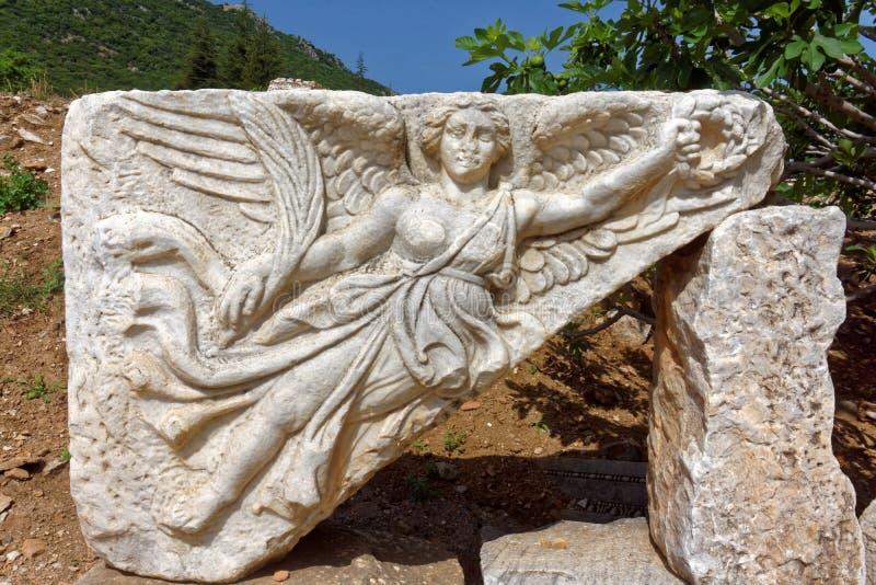 Stone carving of goddess nike stock image ruin