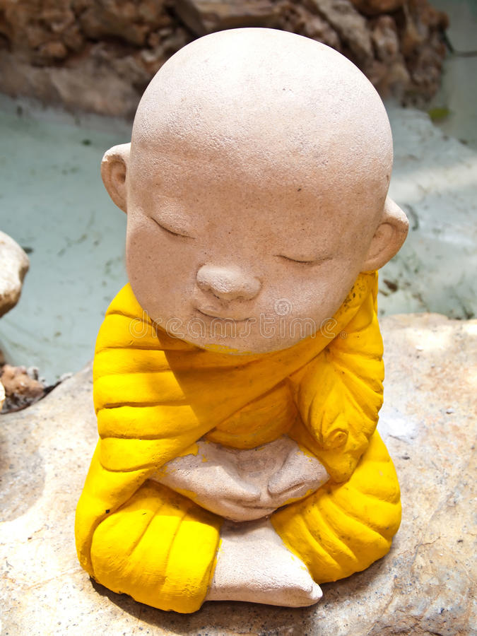 Stone carving of a little Buddha Meditation royalty free stock photo
