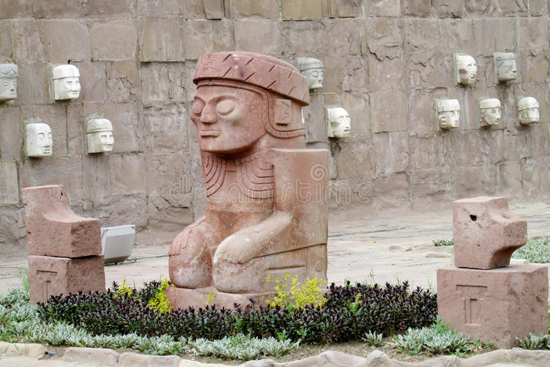 Stone carving sculptures from Tiwanaku. Stone carving face sculptures from Tiwanaku on the square in La Paz, Bolivia stock images