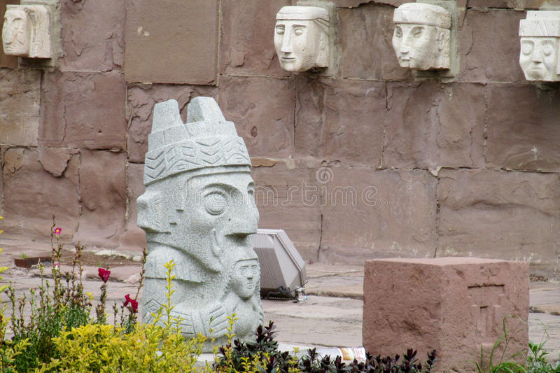 Stone carving sculptures from Tiwanaku. Stone carving face sculptures from Tiwanaku on the square in La Paz, Bolivia royalty free stock photo