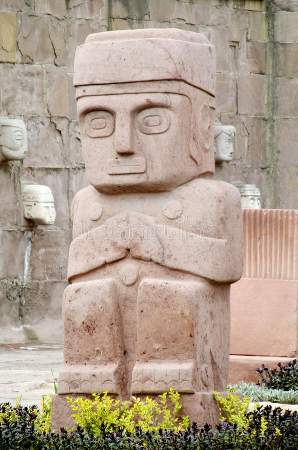 Stone carving sculptures from Tiwanaku. Stone carving face sculptures from Tiwanaku on the square in La Paz, Bolivia royalty free stock photography