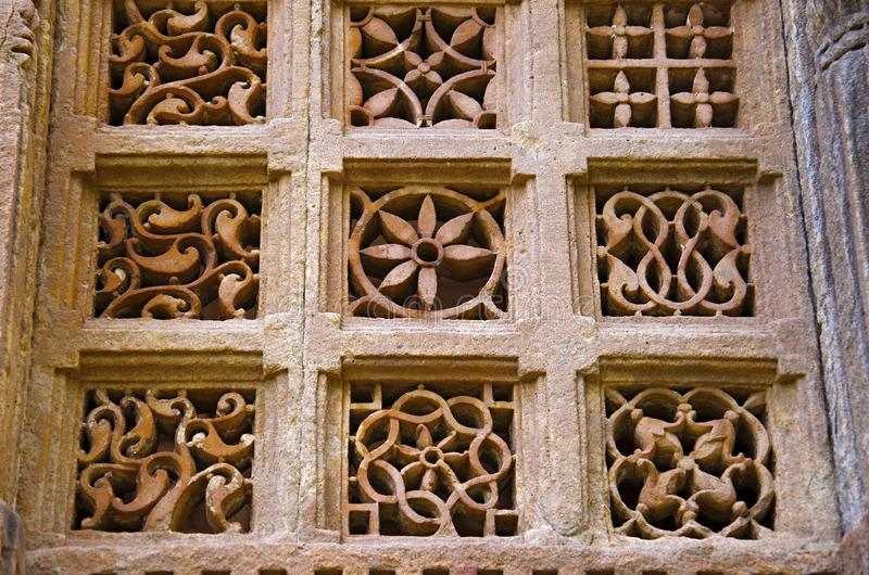 Stone carvings on outer wall of Jami Masjid Mosque, UNESCO protected Champaner - Pavagadh Archaeological Park, Gujarat, India. Dates to 1513, construction over royalty free stock images