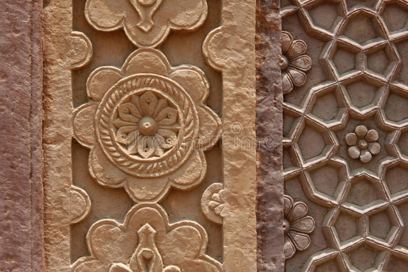 Stone carvings on the wall of a temple in India