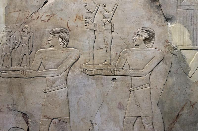 Stone carvings of an ancient Egyptian temple. Stone carvings on the walls of an ancient Egyptian temple stock photos