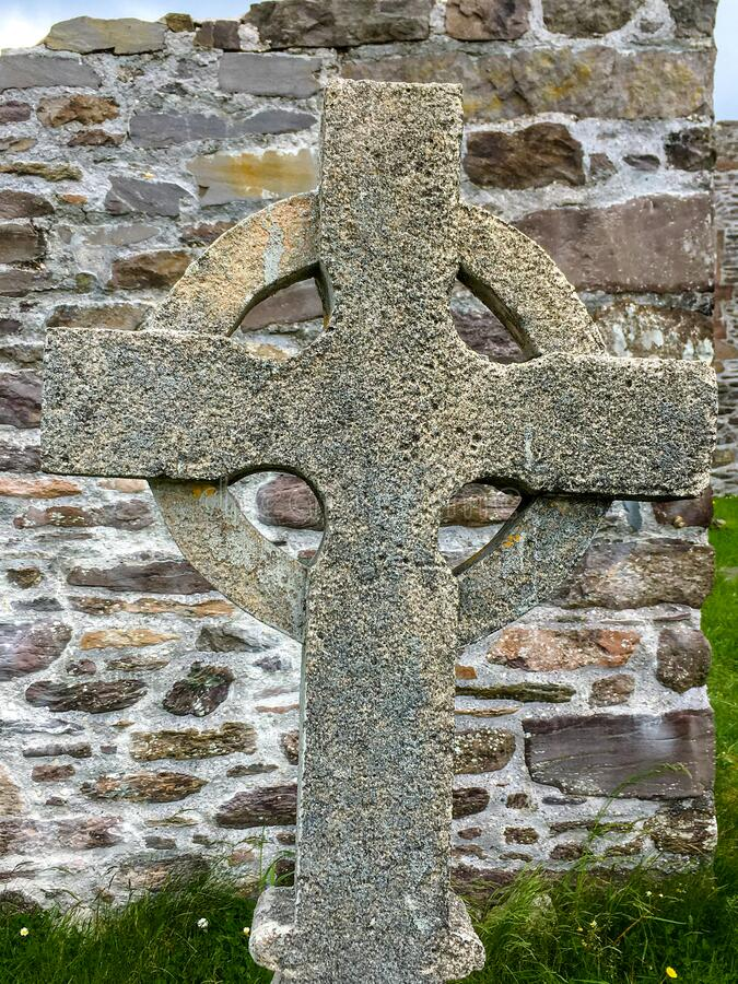 Stone Celtic Cross with flat stone background. This is a picture of a Stone Celtic Cross with flat stone background royalty free stock photos