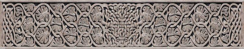 Stone Celtic Knot - Detail on Celtic Cross royalty free stock photo
