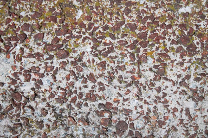 Stone in cement. textures and backgrounds royalty free stock photography
